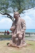 Statue of Christopher Columbus at the Malecon of Baracoa - stock photo