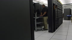 Reveling view of man working on network server Stock Footage