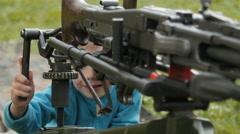 Kids touches a machine gun Stock Footage