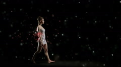 Ballet dancer is dancing alone on stage sorrounded by red petals Stock Footage