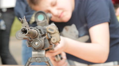 Kids touches a machine gun - stock footage