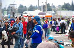 QUITO, ECUADOR - JULY 7, 2015: Several focus on men, garbage cleaner after pope - stock photo