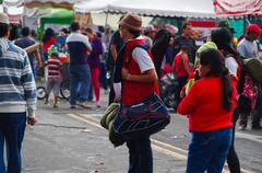 QUITO, ECUADOR - JULY 7, 2015: Unidentified men with hat and a big backpack - stock photo