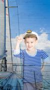 Double exposure a little boy seaman and yacht - stock photo