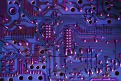 Overhead close up of purple colour circuit board - stock photo