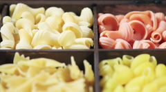 Assorted different kinds of pasta in a wooden box. - stock footage