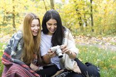 Young women smiling at camera in forest, Hampstead Heath, London Stock Photos