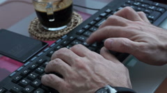 Hands of man with wristwatch and smartband typing on  computer keyboard Stock Footage