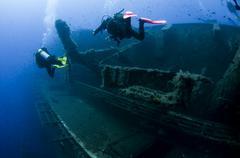 Underwater rear view of divers investigating MS Zenobia shipwreck, Larnaca, Stock Photos