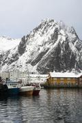 View of harbour and snow capped mountains, Svolvaer, Lofoten Islands, Norway Stock Photos