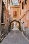 Arched street in the town of Chioggia, Italy - stock photo