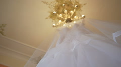 Wedding dress hanging in the room Stock Footage