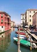 Characteristic canal in Chioggia, lagoon of Venice. - stock photo
