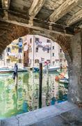 Chioggia glimpse from the arcades. Stock Photos