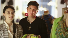 Young fashion designers portrait in their tailor's shop Stock Footage