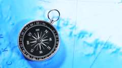 Compass on a wooden table and a map Stock Footage
