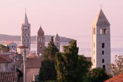 The town of Rab, Croatian tourist resort famous for its four bell towers. - stock photo