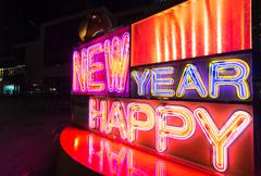 Happy new year displayed by neon light Stock Photos
