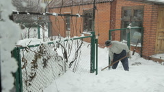 Man remove snow near the house Stock Footage