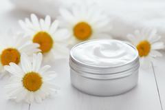 Herb cosmetic anti wrinkle cream chamomile vitamin spa organic moisturizer Stock Photos