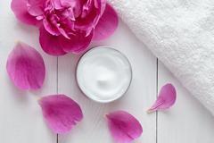 Hygienic herbal cosmetic cream vitamin spa lotion natural organic moisturizer Stock Photos