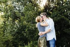 Couple sharing passionate kiss in park Stock Photos