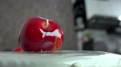 Fruit worm crawls into rotten cherry, cinematic background Stock Footage