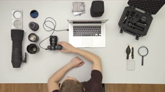 The man work with camera tool on the desktop. Real time capture. Wide angle - stock footage