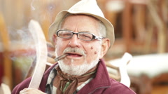 Senior secondhand dealer smoking cigar portrait in his shop Stock Footage