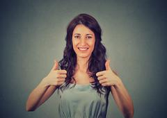 Thumb up. Business woman isolated on gray wall background. Female model. Stock Photos