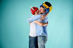The two football fans over blue Kuvituskuvat