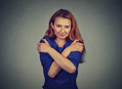 Confident smiling woman holding hugging herself Stock Photos