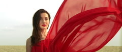 Lady Throwing Red Dress With Light Reflections on Face in Slow Motion Stock Footage