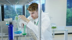 4K Research scientists studying plants in agriculture or pharmaceutical industry Arkistovideo
