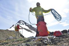 Two mountain climbers on mountain, Chugach State Park, Anchorage, Alaska, USA Stock Photos