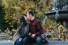 Mid adult couple kissing at Bethesda fountain in Central Park, New York, USA Stock Photos