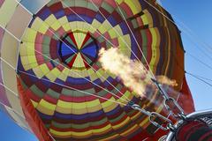 Low angle view of hot air balloon and blue sky, Cappadocia, Anatolia,Turkey Stock Photos