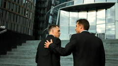 businessmen pat on the shoulder and talking - stock footage