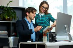 Young colleague - man and woman working from home - modern business concept Stock Photos