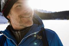 Close up sunlit portrait of mature man hiking in snow covered landscape, Berg, Stock Photos