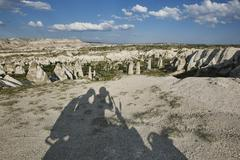 Selfie shadow of tourists on moped in landscape, Cappadocia, Anatolia,Turkey Stock Photos
