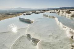 White hot spring terraces, Pamukkale, Anatolia, Turkey - stock photo
