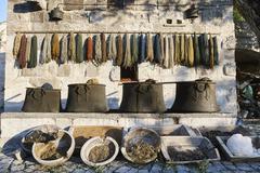 Rows of old traditional textiles and bowls, Cappadocia, Anatolia,Turkey - stock photo