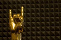 Golden Hand Showing Horns Stock Photos