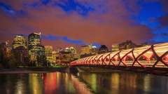 Time Lapse Peace Bridge across the Bow River in Calgary Stock Footage