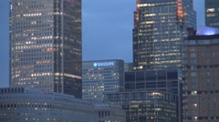 Close view skyscrapers facade with corporate business offices lighted in a eveni Stock Footage