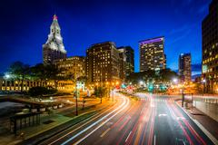 Pearl Street and modern buildings at night in downtown Hartford, Connecticut. Stock Photos