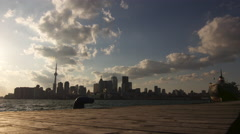 Toronto Cityscape Viewed from a Dock During the Evening : Time Lapse Stock Footage