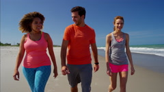 Young multi ethnic people enjoying their exercising for weightloss on the beach Stock Footage