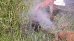 Beekeeper and smoker. Man with a smoker for bees - stock footage